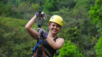 young girl doing a zipline